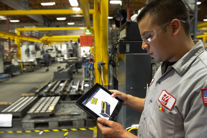 A worker with an iPad.